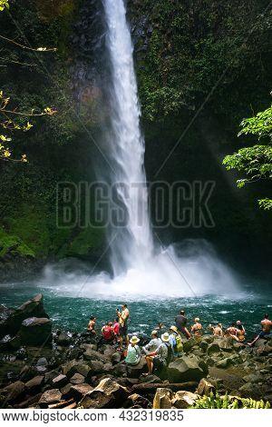 La Fortuna, Costa Rica - January 16, 2020 : Tourists And Locals Visiting The La Fortuna Waterfall. T