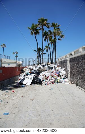 Belmont Shores, California. August 17, 2021:Belmont Shores Trash Dump. A garbage dump area with trash from the beach. The City of Belmont Shores Recreation and Maintenance area trash bin.