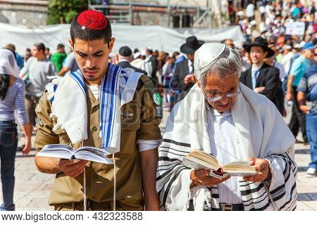 JERUSALEM, ISRAEL - NOVEMBER 16, 2011: Great religious Jewish holiday. The Western Wall - a place of faith and pilgrimage for Jews around the world