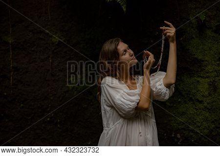 Caucasian Woman Holding Mala For Pray And Meditation. Buddhist Japa Mala Made Of Natural Stones Bead