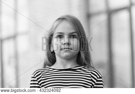 Surprised Little Kid With Long Hair In Stripy Top Keep Eyes Wide Open Outdoors, Surprise