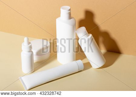 A Set Of Female Professional Cosmetics For Face And Body Care. Cosmetic Tube With Skin Care Product