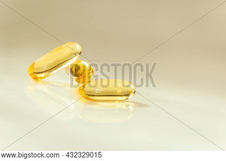 Health Care Concept Close Up Capsules Omega 3 On Blurred Background
