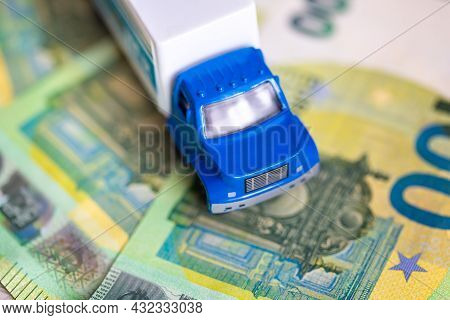 The Truck On Euro Bills. Concept Of An Insurance Contract For New Trucks Or Expensive Fuel