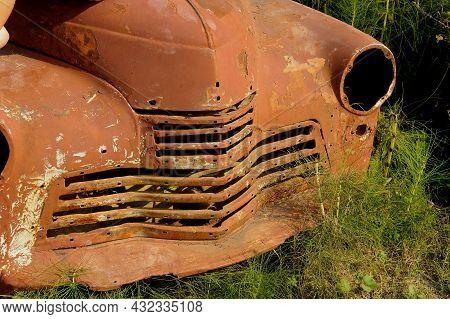 A Rusty Old Car Overgrown With Greenery. Abandoned City, Fleet. Macro