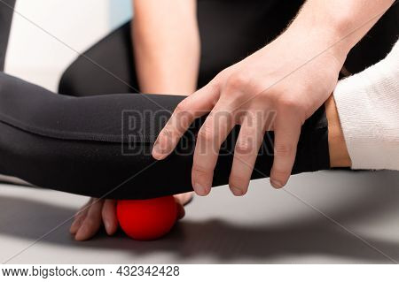 Physiotherapist Teaches Self-massage With Red Balls, Patient With Leg Injury. Treatment Of Sports In