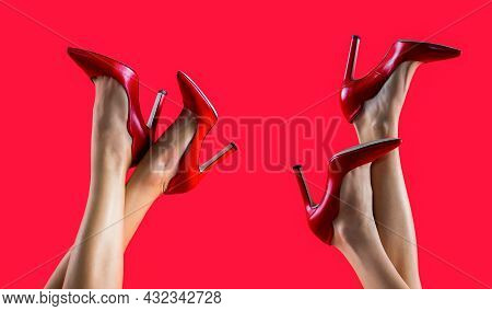 High Heel Shoes. Beautiful Legs Woman. Pretty Female Legs With Red High Heels On Red Background. Per