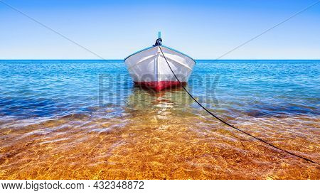 White Fishing Boat On The Blue Sea