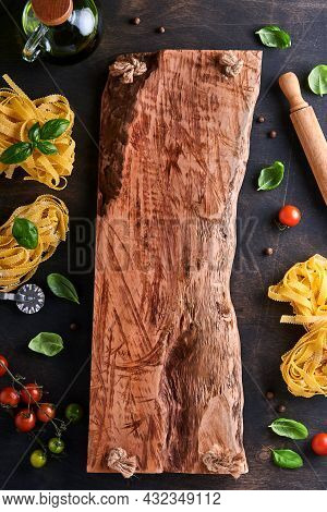 Tagliatelle. Homemade Pasta, Basil Leaves, Flour, Pepper, Olive Oil, Cherry Tomato And Rolling Pin A