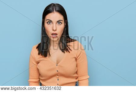 Young hispanic woman wearing casual clothes afraid and shocked with surprise and amazed expression, fear and excited face.