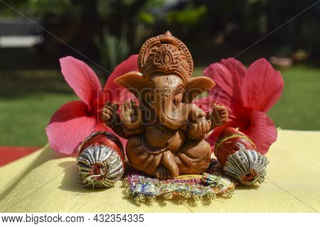 Lord Ganapati Sitting Idol With Pillows And Bolsters At Home During Ganesh Chaturthi Festival At Hom