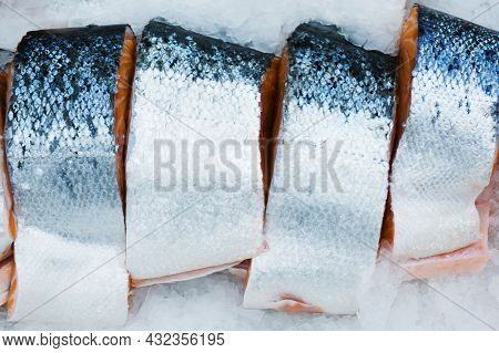 Trout Chunks. Sea Fish In The Ice On The Counter Of The Store. Trade In Seafood