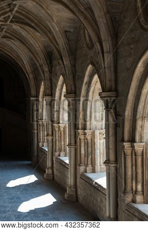 Beautiful Cloister At Evora Cathedral. Stone Arches, Gothic Style. Portugal, Europe
