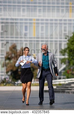 Business Man And Woman Walking In Rush On City Square, Running On Meeting, Being Late And In Hurry C