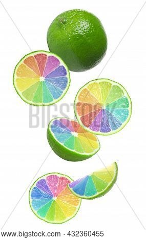 Fresh Limes With Rainbow Segments Falling On White Background. Brighten Your Life