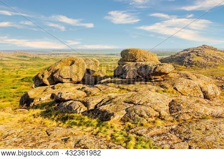 Nice autumn landscape with old stones in steppe