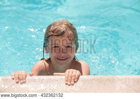 Cute Child Boy Swim In Swimming Pool, Summer Water Background With Copy Space. Happy Little Kid Boy