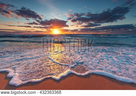 Sunrise Over The Tropical Beach And Sea