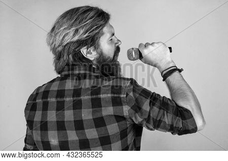 Catch The Tune. Mature Charismatic Male Vocalist. Guy With Beard Singing In Microphone. Confidence A