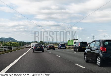 Manchester, Uk - August 29, 2021: Slow Moving Traffic Jam With Distance Between Cars, Wind Turbines