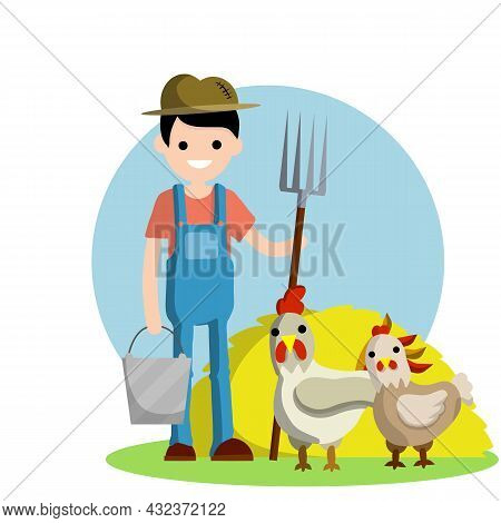 Young Man In Blue Farmer's Overalls Stands With Pitchfork In His Hands Next To Yellow Haystack. Farm
