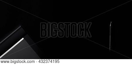 Electronic Drawing Pen Tablet With Pen Stylus Isolated On Black Background. Copy Space. Banner. Empt