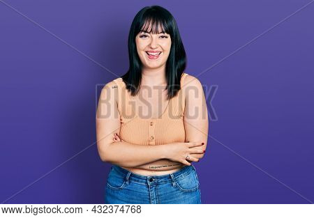 Young hispanic plus size woman with arms crossed gesture smiling and laughing hard out loud because funny crazy joke.