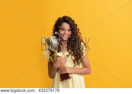 Happy Child Holding Golden Champion Cup As Winner, Award