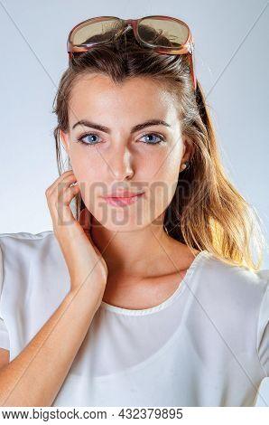 Young Pretty Girl Closeup Looking At Camera