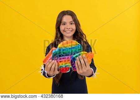 Happy Kid Holding Many Pop It Or Popit Silicone Sensory Fidget Toys, Childhood Craze