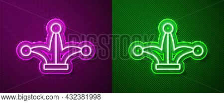 Glowing Neon Line Joker Playing Card Icon Isolated On Purple And Green Background. Jester Hat With B