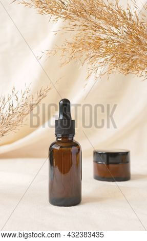 Kit Cosmetic Containers For Beauty Product Mockup On Linen Drapery And Dry Branch Of Meadow Plant. C