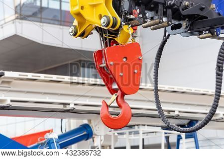 A Close-up Of The Hook Of A New Mobile Crane. Wheeled Construction Equipment. Parts Of Construction