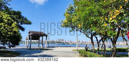City Tamsui Bali District In Taipei, Taiwan Reflecting In The Tamsui River At Nice Day