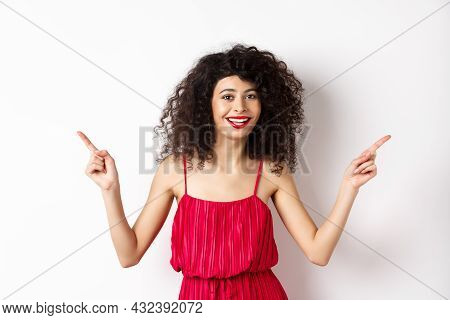 Happy Lady With Curly Hairstyle And Red Lips, Smiling White Teeth, Pointing Sideways At Two Ways, Sh