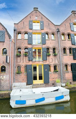 Multi-level Accommodation Constructed In Brick With Inflatable Moored In Canal Below In Picturesque