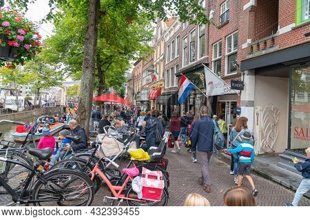 Alkmaar Netherlands - August 18 2012; Busy Street Crowded With Tourists Walking And At Cafes In Pict
