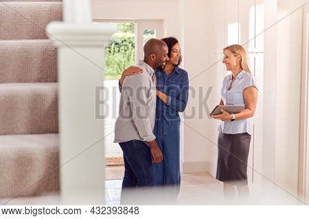 Couple Viewing Potential New Home With Female Realtor