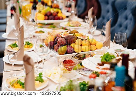 Large Festive Table. A Large Plate With A Fruit Platter In The Center.