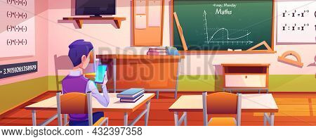 Student Or School Boy Communicate By Cell Phone Sitting At Desk In Classroom Front Of Blackboard. Mo