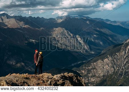 A Couple In Love On A Rock Admires The Beautiful Views. A Man And A Woman On A Rock. A Couple In Lov