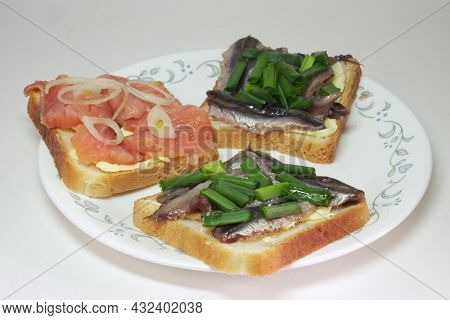 Sandwiches With Solted Europian Sprat And Slices Of Salted Salmon, On Butter, Seasoned With Chopped