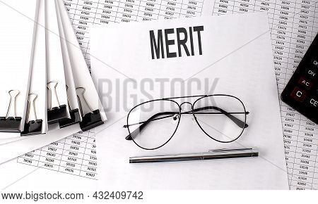 Merit Text On The Paper With Chart And Office Tools , Business Concept