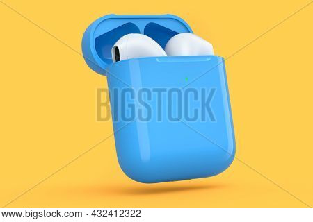 Wireless Bluetooth Headphones In Blue Case Isolated On Orange Background