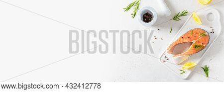 Fish Restaurant Banner. Fresh Salmon Or Trout Steak With Salt, Pepper, Lemon And Rosemary On A Board