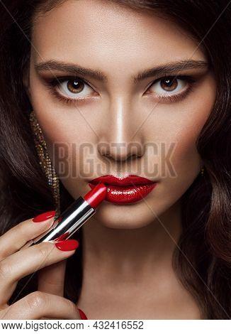 Woman Beauty Portrait With Red Lips Make Up. Glamour Model Applying Lipstick, Smokey Eyes. Proffesin