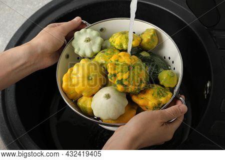 Woman Washing Pattypan Squashes Above Sink, Closeup
