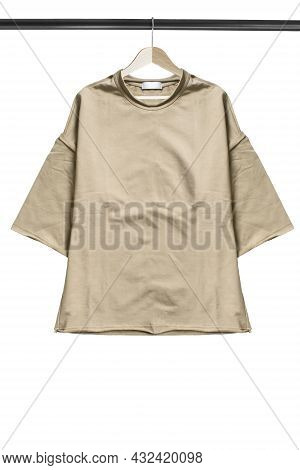 Basic Cotton Sweatshirt Hanging On Wooden Clothes Rack Isolated Over White