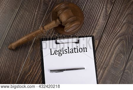 Legislation Text On Paper With Gavel On The Wooden Background