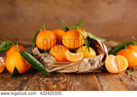 clementine- mandarin fruit and leaf
